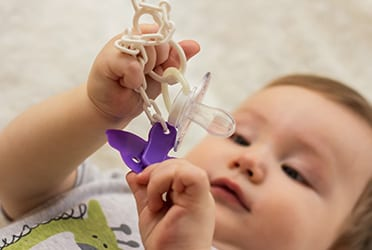 Précon Quality Services - Speenkoord of speelgoed?